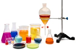 Chemical laboratory glassware with various colored liquids on table. Laboratory Research - Scientific Glassware For Chemical Background.