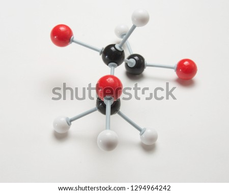 Chemical model with red,whte and black balls to signify atoms. #1294964242