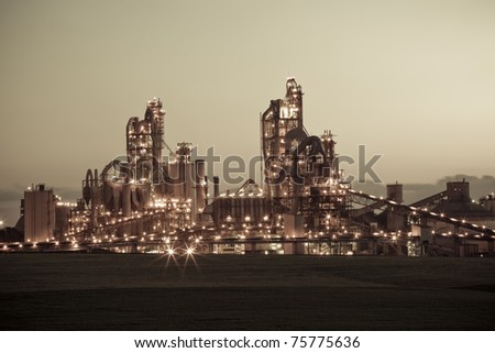 Chemical plant at night - Sepia Toned Modern factory.