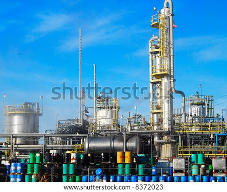 Chemical Plant with drums stacked in front