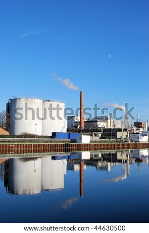 Chemical plant with reflection on a river