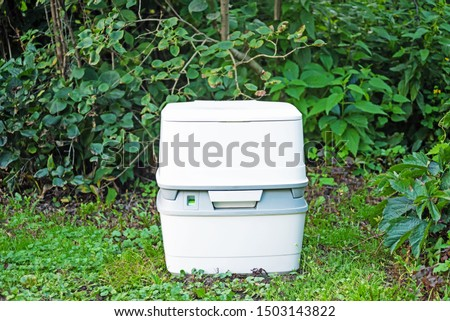 Chemical portable toilet. Single portable toilet standing on a green nature courtyard background   #1503143822