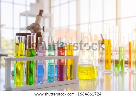 Chemical reagent bottles, scientific experiment bottles of various shapes, sizes and microscopes on the table
