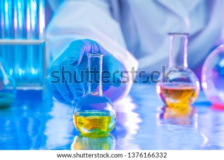 Chemical research. The chemist observes the chemical reaction in the solution. Analytical chemistry. Reagents for the laboratory. Laboratory test. Medical expertise.