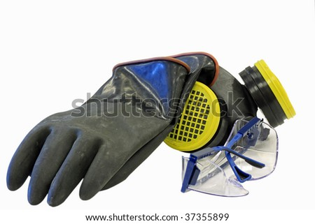 Chemical safety equipment including, glasses, gloves and respirator. - stock photo