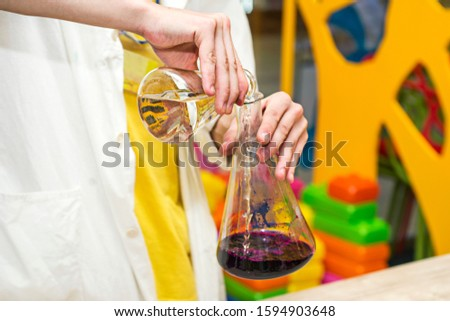 Chemical show for kids. Professor carried out chemical experiments. Experiments for children.