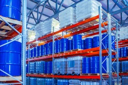 Chemical storage warehouse. Containers for chemical liquids. Warehouse system. Toxic barrels are kept in stock. Warehouse storage. Chemical Industry. Plastic barrels of chemicals are on pallets.