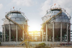Chemical tank, refinery industry plant and sunset use for energy and industrial background.