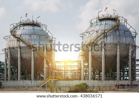 Chemical tank, refinery industry plant and sunset use for energy and industrial background. stock photo