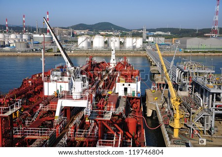 chemical tanker during unloading operation ship to ship in the port