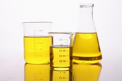 Chemical test tubes and flasks with yellow oil