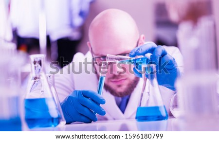 Chemist a man works in a laboratory. Laboratory research concept.