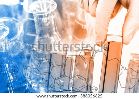 Chemist \'s gloved hand holding the test tube at laboratory, with chemical equations and periodic table background.