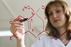 chemist writing a formula