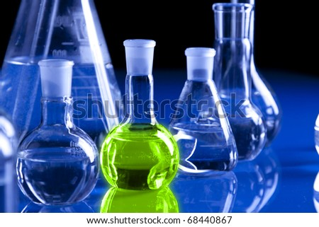 Chemistry equipment, laboratory glassware on blue background