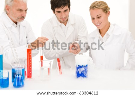 Chemistry experiment -  scientists in laboratory testing flu virus vaccination