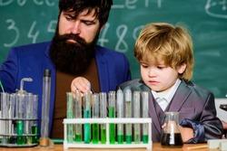 Chemistry experiment. Teacher child test tubes. Cognitive process. Kids cognitive development. Mental process acquiring knowledge understanding through experience. Back to school. Cognitive skills.