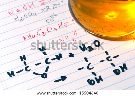Chemistry formulas and laboratory pipette glass conical Erlenmeyer flask filled with orange liquid on hand written scientist notes in a science research lab