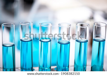 Chemistry laboratory glassware, science laboratory research and development concept, flask, beaker, and test tubes with blue liquid water sample test, scientific test tubes equipment Stockfoto ©
