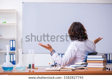 Chemistry lecturer during lecture in college #1582827745