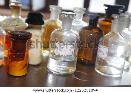 chemistry of the bottle with acids and bases