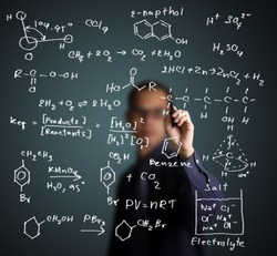 chemistry teacher writing science and chemical formula on whiteboard