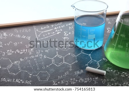 Chemistry teaching with drawn blackboard with chemical instruments. Chemical sciences education concept. Horizontal composition. Elevated view
