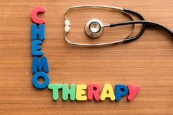 chemotherapy colorful word on the wooden background with stethoscope