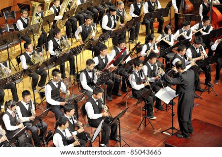 CHENGDU - APR 23: student symphonic band of High School No.7 Chengdu perform on concert on Apr 23,2011 in Chengdu,China.