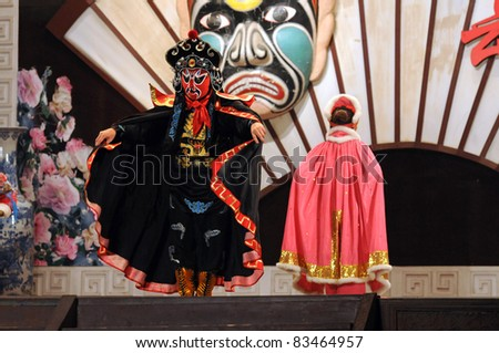 "CHENGDU - AUGUST 12: Actors of the Sichuan Opera Troupe perform the famous ""changing faces show"" at the Culture Park Theater on August 12, 2010, in Chengdu, China."