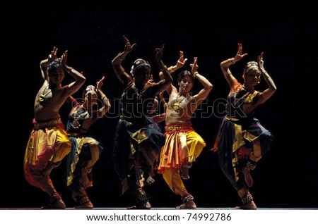 CHENGDU, CHINA - OCT 24: Indian dancers perform folk dance onstage at Jincheng theater during the festival of India in China on Oct 24, 2010 in Chengdu, China.
