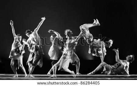 CHENGDU - DEC 15: chinese dancers perform folk dance on stage at JINCHENG theater.Dec 15,2007 in Chengdu, China. Choreographer: Hou Bo, actor: Yang Xiaofan, Yang Yang, Zhong Shan - stock photo