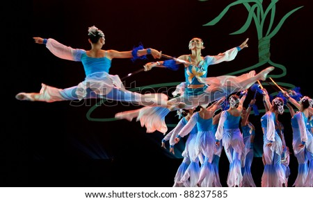 CHENGDU - DEC 10: Chinese dancing girls perform modern dance onstage at JINCHENG theater in the 7th national dance competition of china.Dec 10,2007 in Chengdu, China.