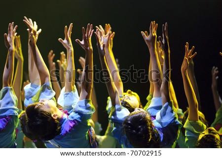 "CHENGDU - DEC 10: Group dance ""That year bobbed"" performed by QIANXIAN art troupe at Golden theater Dec 10,2007 in Chengdu, China. Choreographer: Li Chunyan, etc., actor: 20"