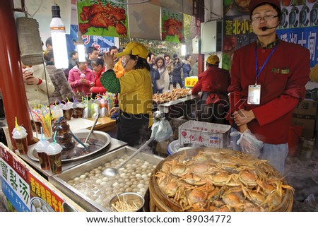 CHENGDU - FEB 7: Salesman selling food in snack bar in a park during chinese new year on Feb 7, 2011 in Chengdu, China.