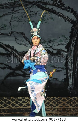 CHENGDU - MAY 30: chinese Beijing opera performer make a show on stage to compete for awards at Shengge theater in 25th Chinese Drama Plum Blossom Award competition.May 30, 2011 in Chengdu, China.
