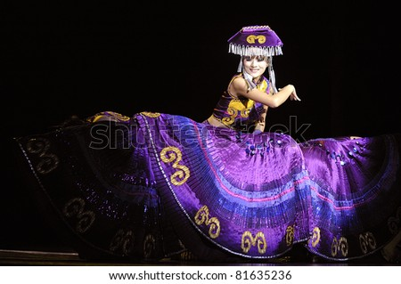 CHENGDU - SEPT 26: Chinese Yi ethnic dancer performs on stage at JIAOZI theater.Sept 26, 2010 in Chengdu, China.