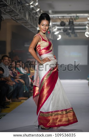 CHENNAI - JULY 21: A model walks on the ramp showcasing Anuradhaa Bisani work during the Chennai International Fashion Week runway on Jul 21, 2012 in Chennai , India.