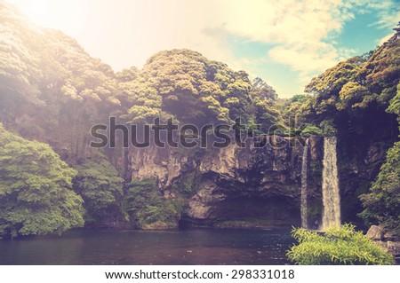 cheonjiyeon waterfall is a...
