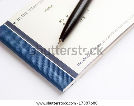 cheque book and pen - stock photo