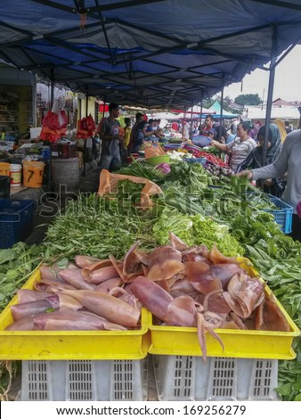 CHERAS, KUALA LUMPUR, MALAYSIA-DEC. 29: Unidentified people buy local produce at a local wet market in Cheras, Kuala Lumpur, Malaysia on December 29, 2013.