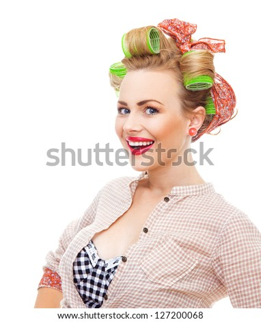 Cherfull smiling pin up retro girl with curlers. Close-up young housewife isolated on white background