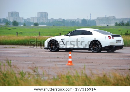 CHERKASSY, UKRAINE - JUNE 1: White Nissan GT-R in the Championship of Ukraine in drag racing during rainy weather, 1 June 2014, Cherkassy, Ukraine