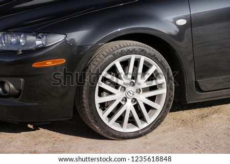 "Chernihiv, Ukraine - November 10, 2018: Part of a Mazda car. Wheels and tires ""Continental"" #1235618848"
