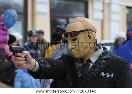 CHERNIVTSI, UKRAINE-JAN.15 : A man dressed as a Vladimir Putin on Malanca Folk Festival in Chernivtsi, Ukraine on January 15, 2012. Putin is a politician who served as a second President of the Russia