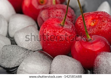 Cherries and ice cubes with drops