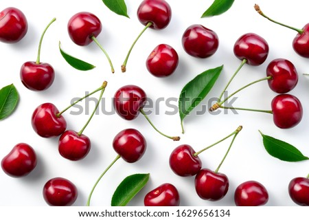 Cherries. Cherry background. Cherries top view. Cherry with leaves on white background.