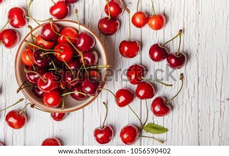 Cherries. Cherry. Cherries in color bowl and kitchen napkin. Red cherry. Fresh cherries.
