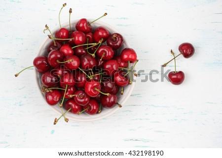 Cherries. Cherry. Cherries in white bowl. Red cherry. Fresh cherries. Cherry on white background. Cherries isolated on white. Healthy cherry fruits. Cherries.