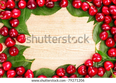 cherries frame on wooden background